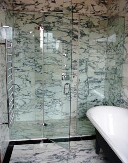 Hinged door shower enclosures